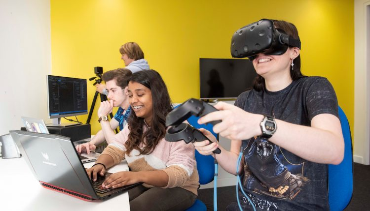 Two female students using VR games equipment