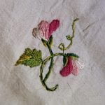 Embroidered vetch or sweet pea flower