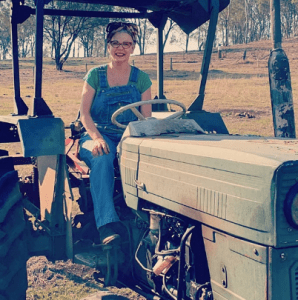 Jessica on a tractor