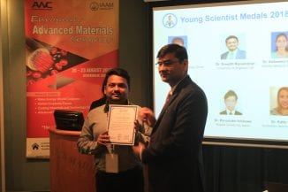 Dr Sreejith Raveendran receiving IAAM award