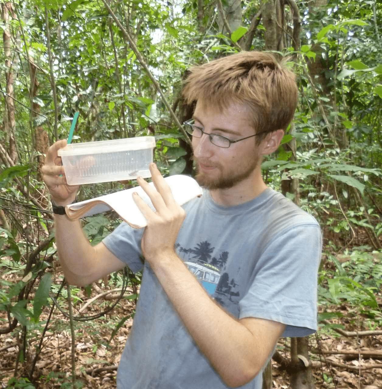 Sammuel Penny examining a frog in Madagascar