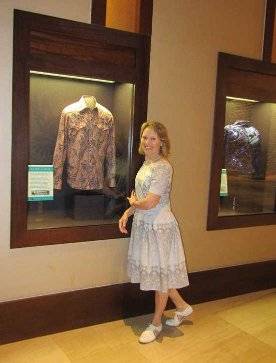 Janet Aspley stands by the shirt she designed in the The Country Music Hall of Fame Museum