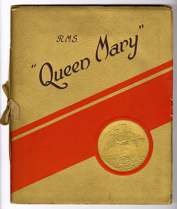 A colour photo of the gold and red R.M.S. Queen Mary souvenir brochure cover