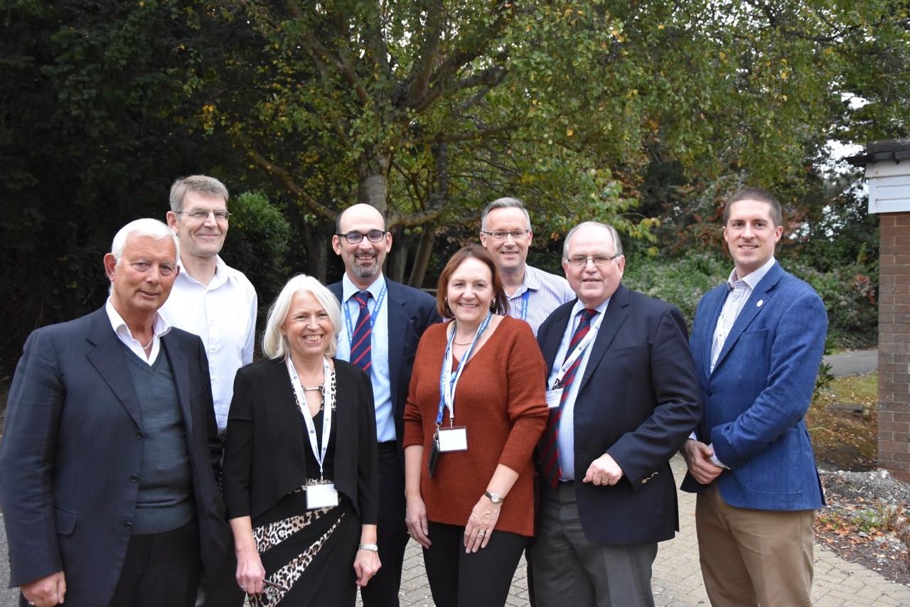 Front Row: Bob Cotton OBE, Trisha Bennet, Julie Barker, Peter Bramich FIH, Adam Rowledge MIH Back row: Jo Doust, Ioannis S. Pantelidis FIH, Chris Dutton