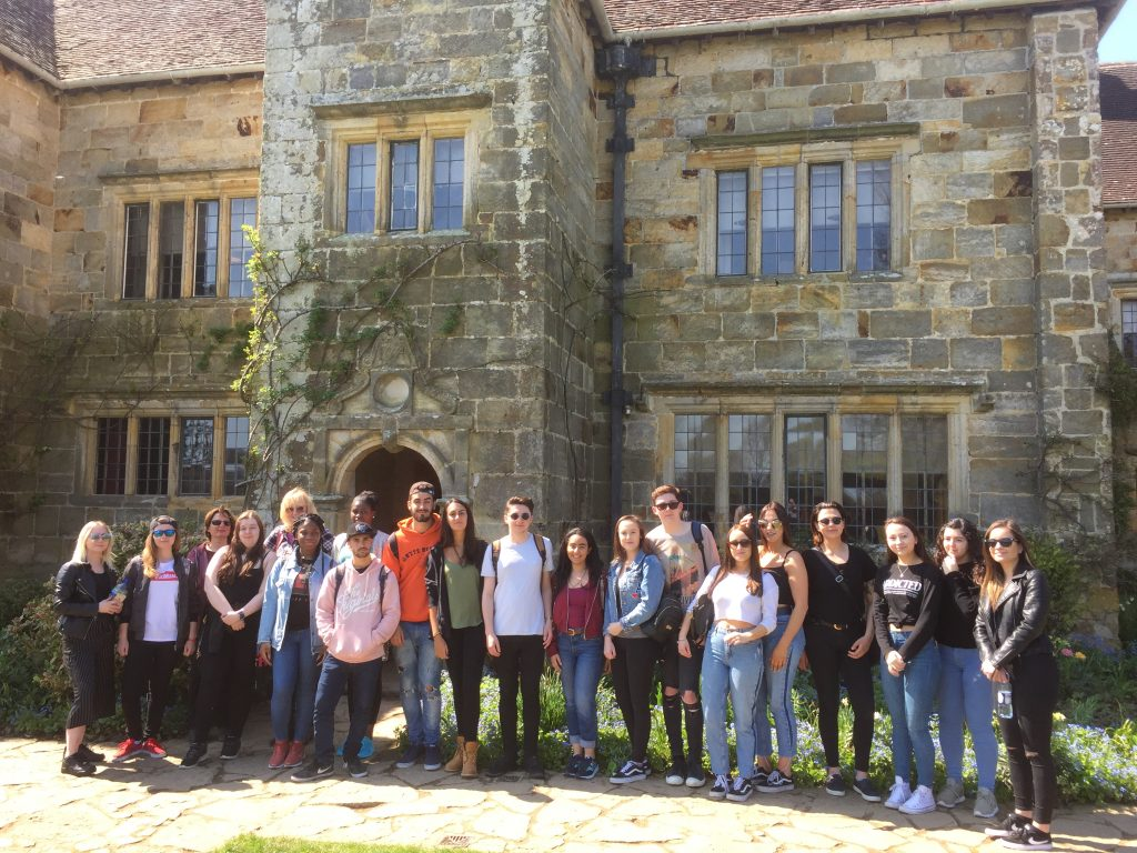 Photo fo the students standing outside the property on glorious sunshine