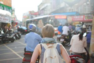 backpacker in a busy street