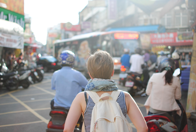backpacker in a busy street