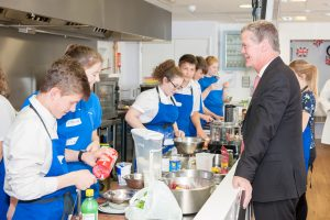 Stephen Lloyd chats to the pupils as they cook their masterpieces