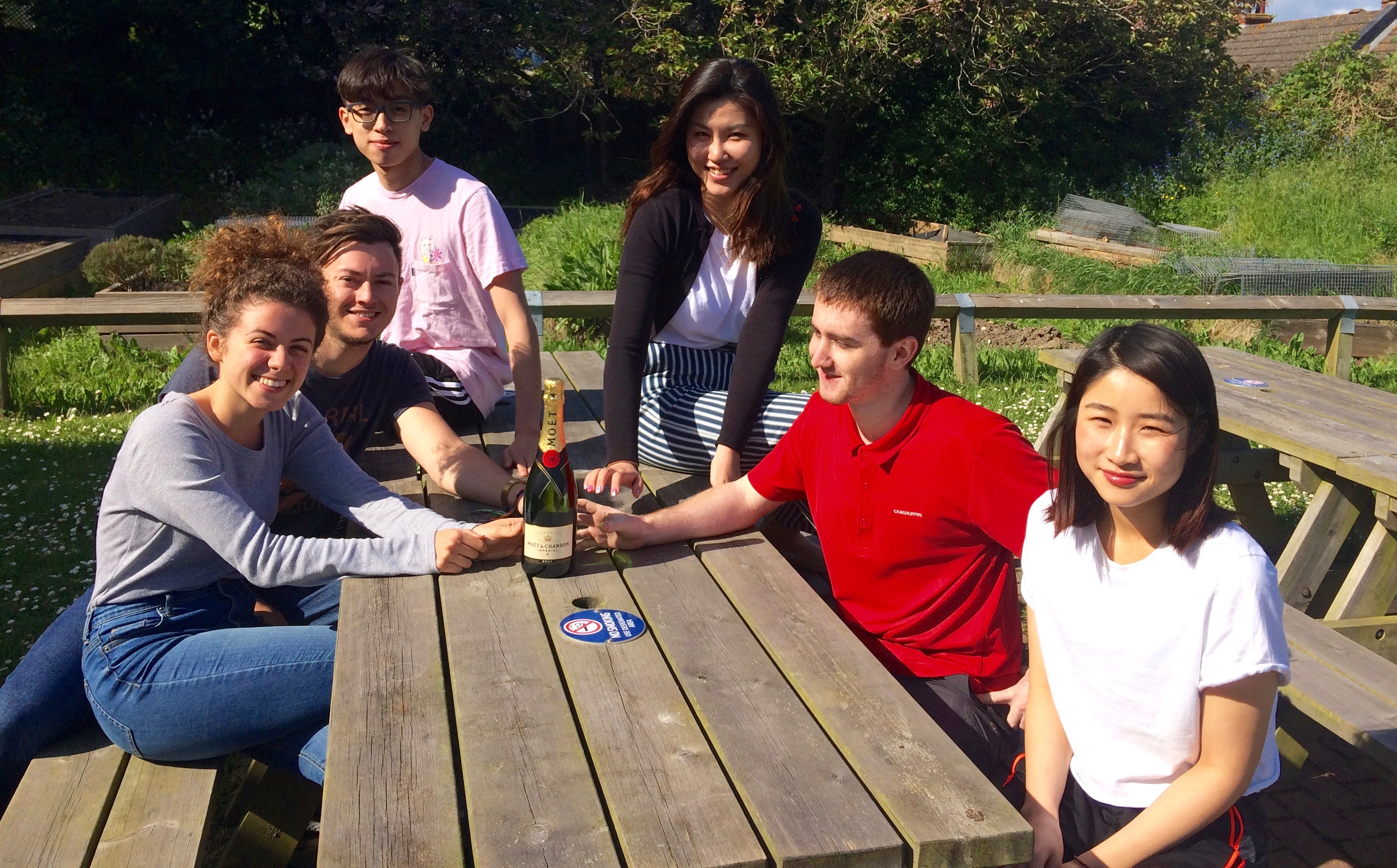 the students celebrating with a bottle of champagne