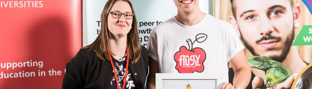 Santander Universities' Holly Price presenting first prize to Harry Kimberley-Bowen