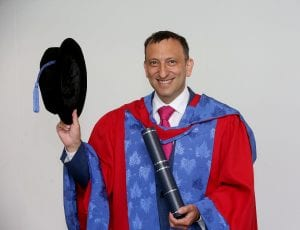 Tony Bloom holding his certificate