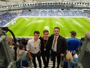 three of the students at the Amex Community Stadium