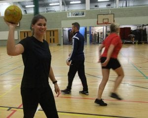 Playing handball in the gym