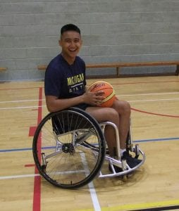 one of the trainees practising his wheelchair basketball skills