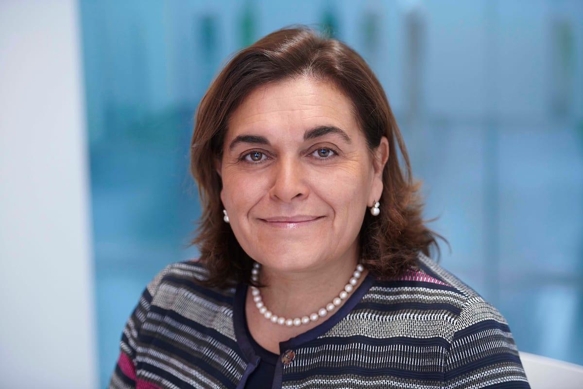 A smiling Marina in a striped jumper