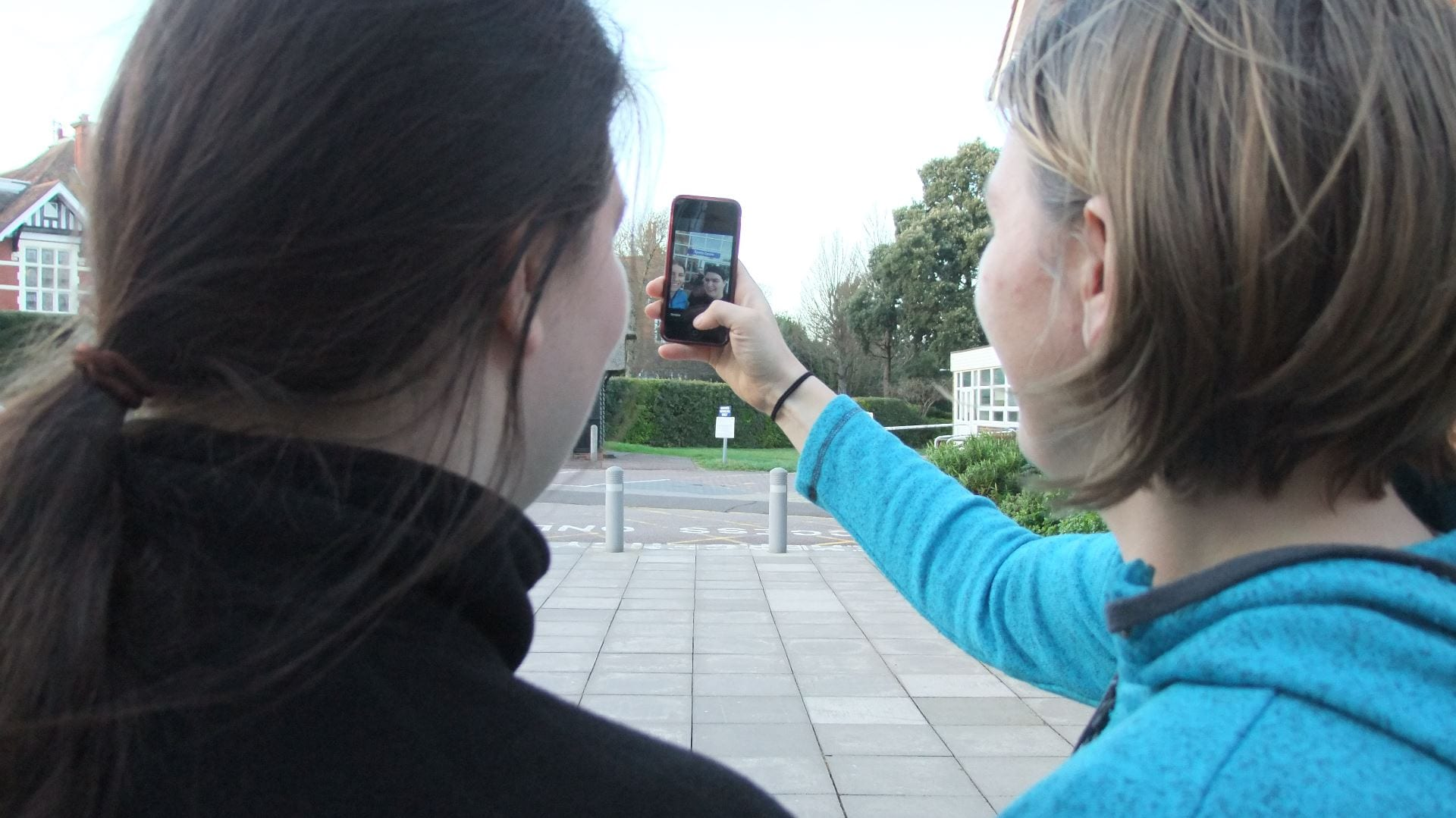 students using their phones