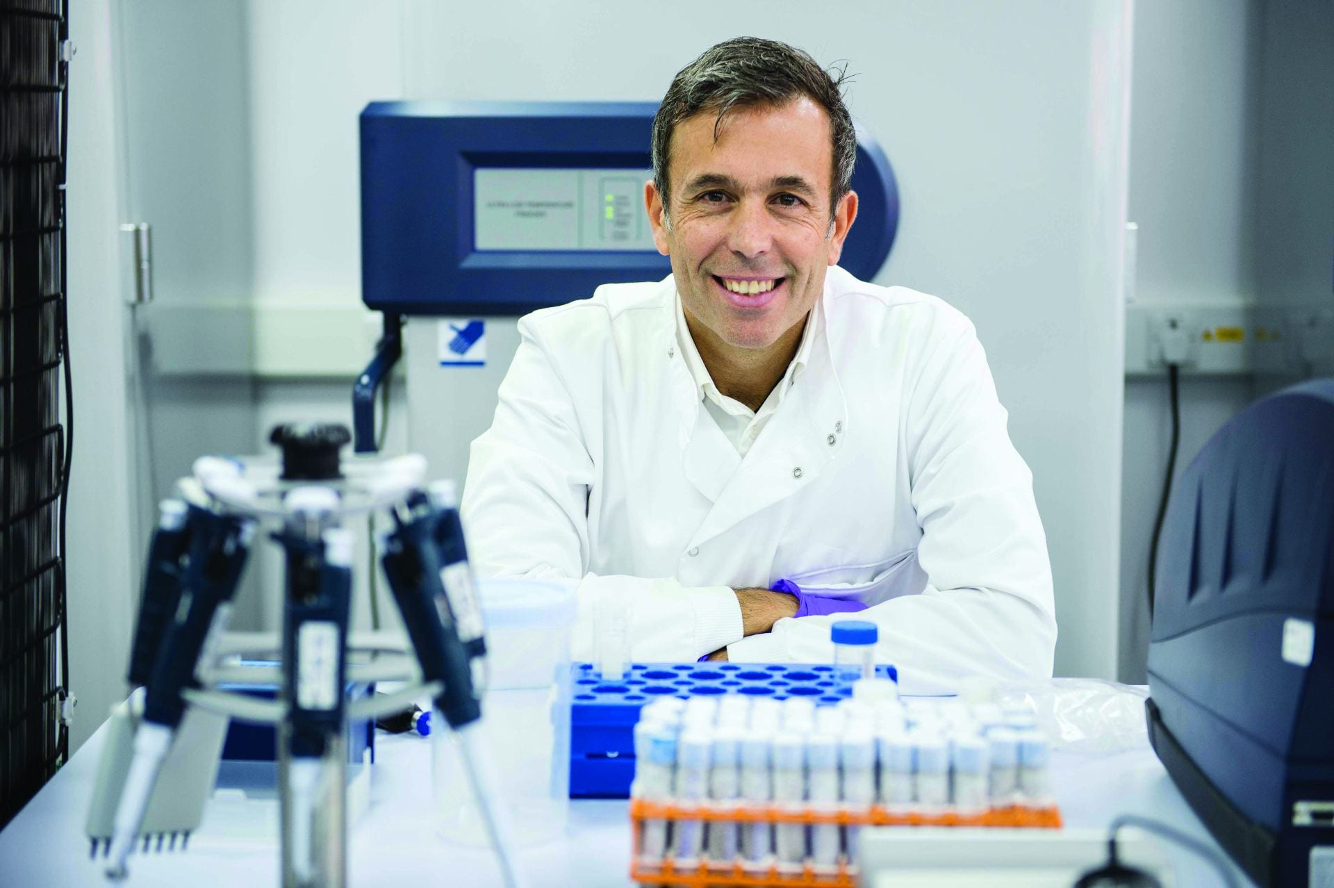 Professor Yannis Pitsiladis in his white coat in the labs