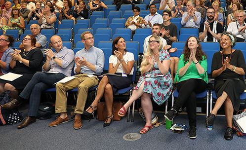 Some of the EFEL award winners clapping at the ceremony