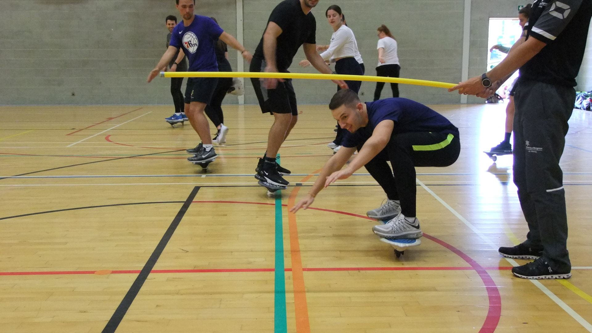 The students street surfing in one of the Eastbourne campus gyms.