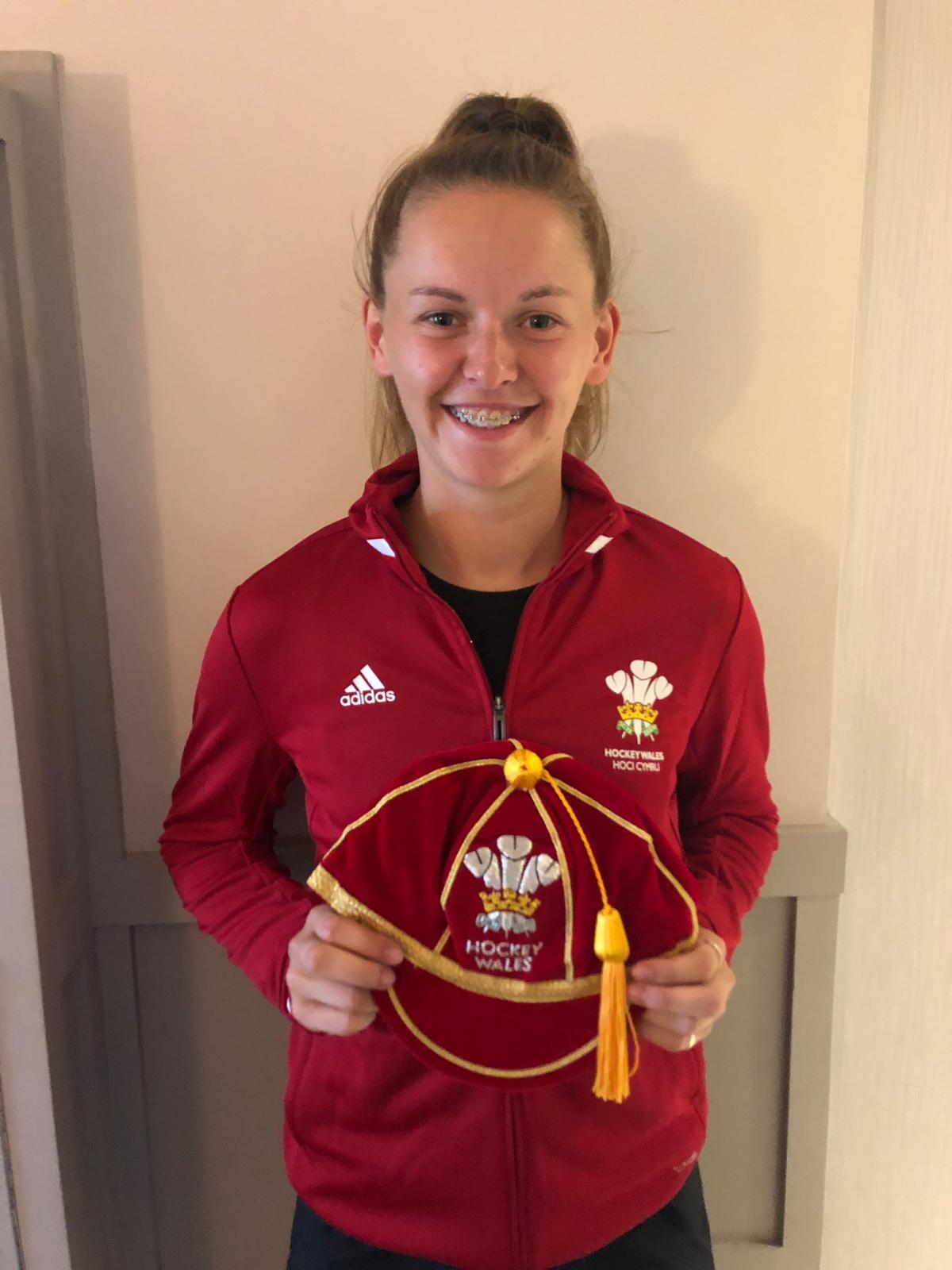 Lauren holding her Wales cap
