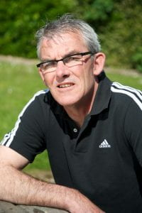 A photo of Gary Stidder who is wearing a black Adidas top