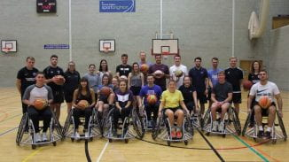 The students in the gym - some of them in wheelchairs