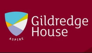 Gildredge House logo whioch has the words on a burgundey background and a colourful shield shape