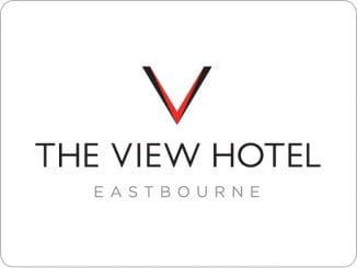 Logo: The view hotel Eastbourne in words in black on a white background with a larve red and black V at the top