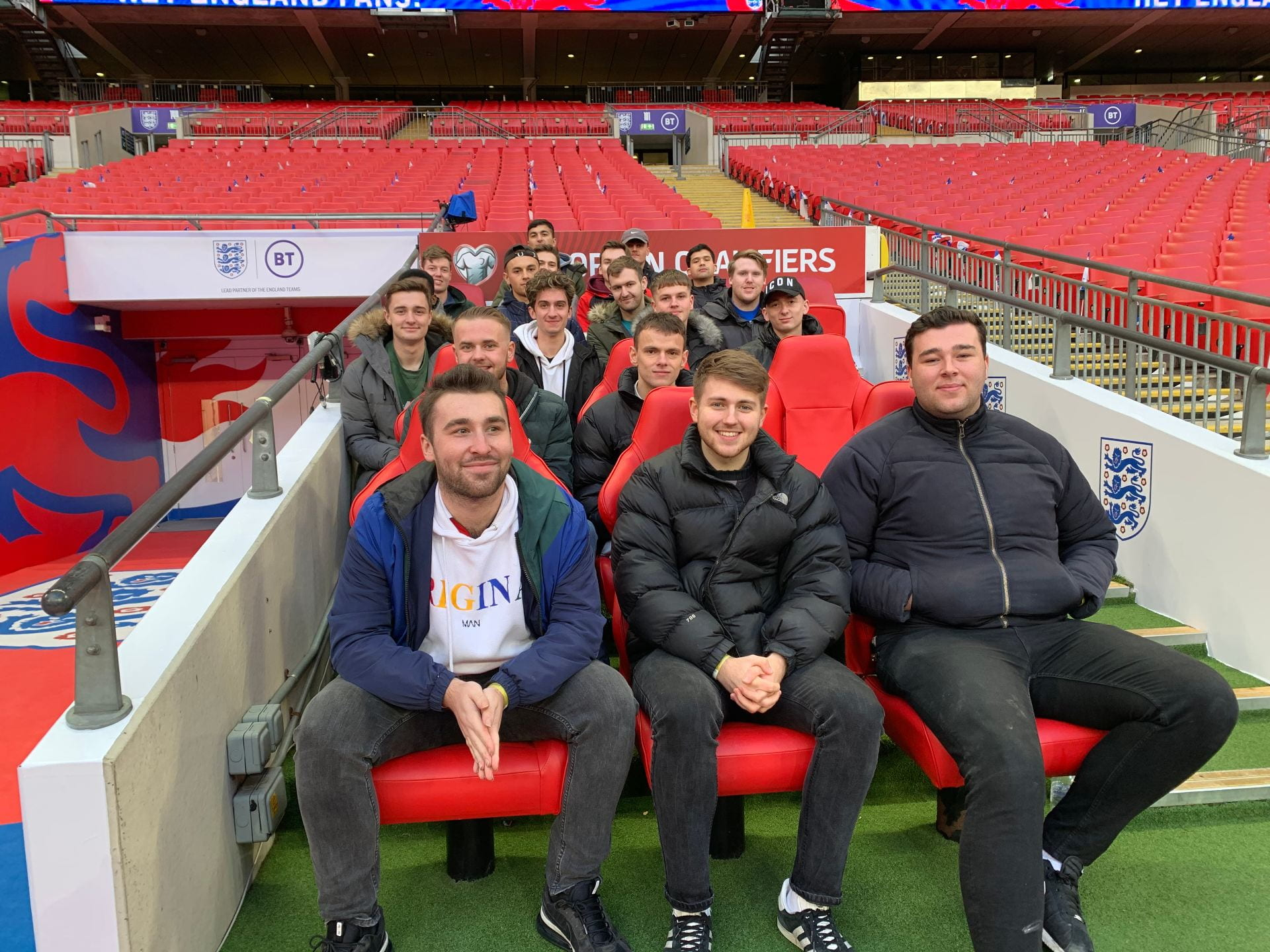 students in the stands at Wembley