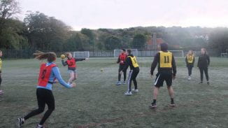 Young adults playing handball