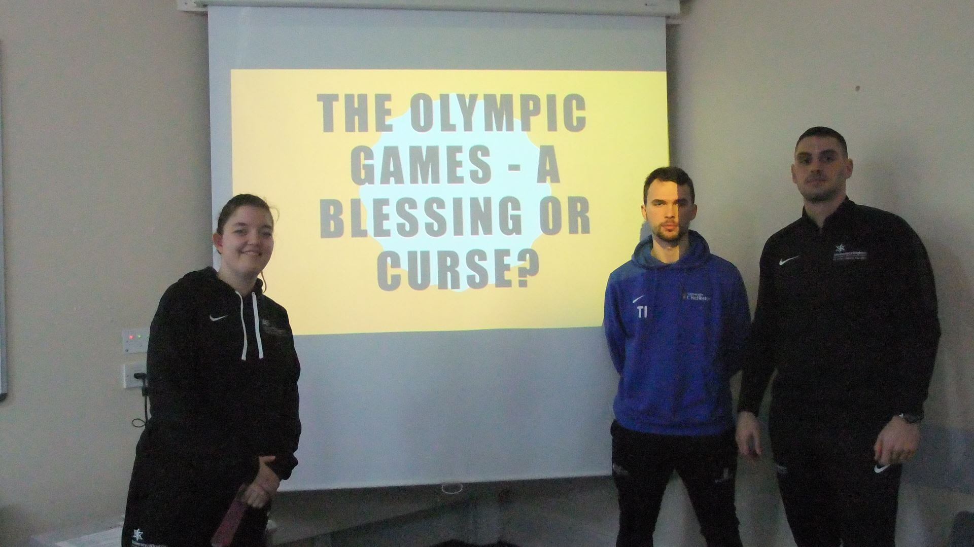 Students standing in front of their presentation