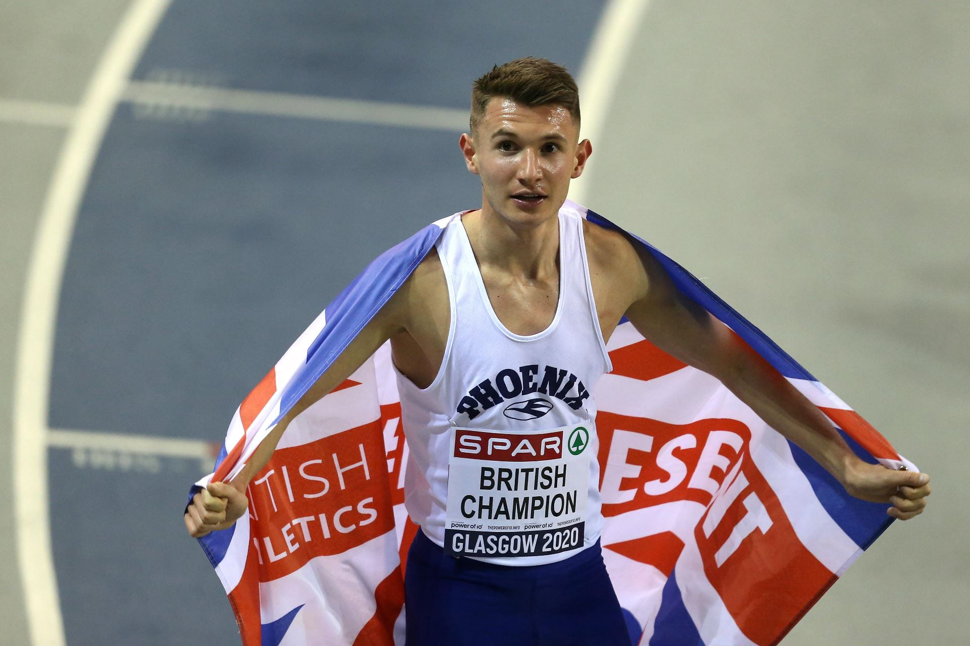 George with the Union Jack flag warapped around his shoulders