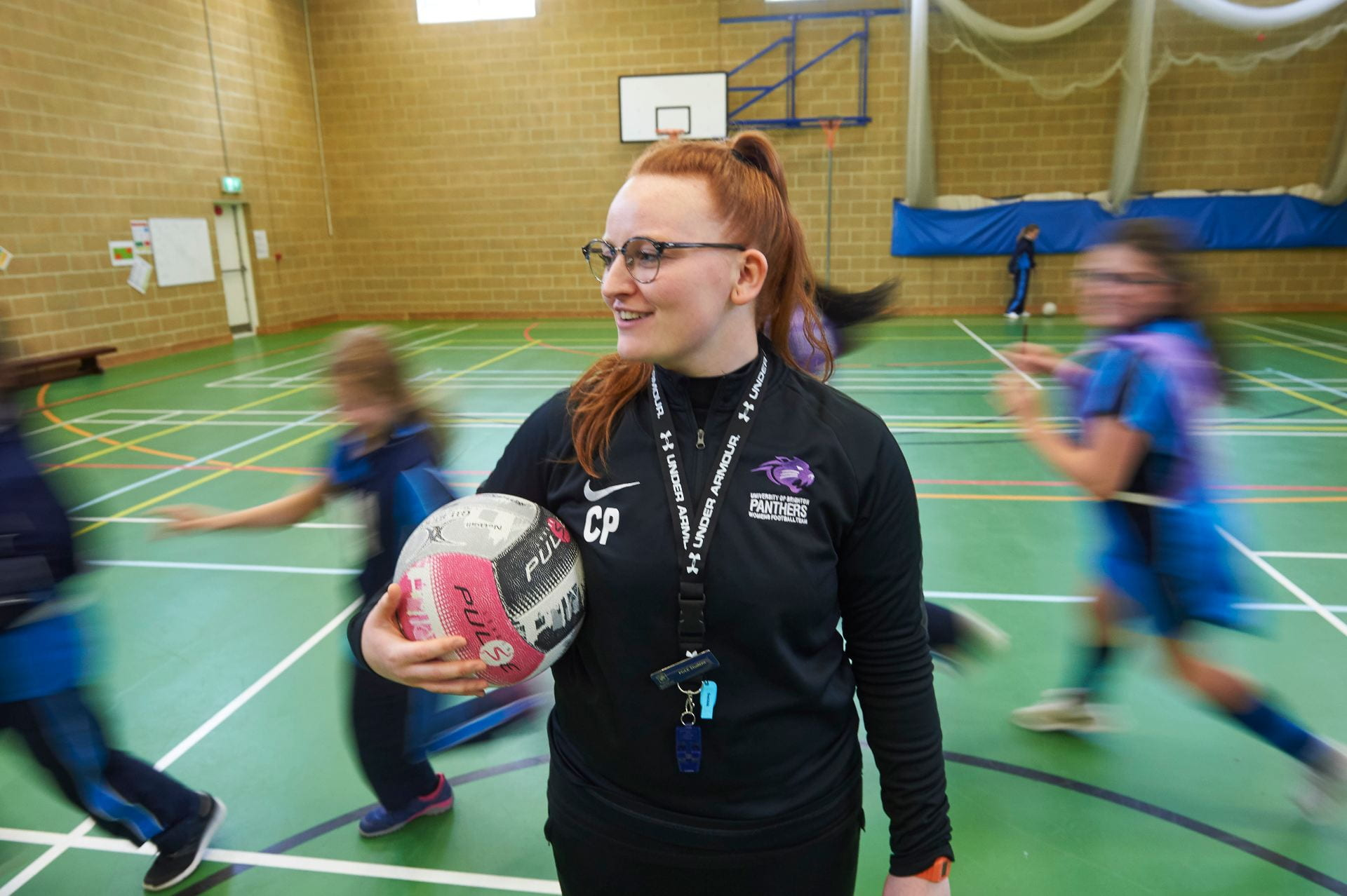 Trainee PE teacher in the gym with a class of children