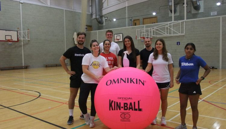 students in the gym with the Kinball