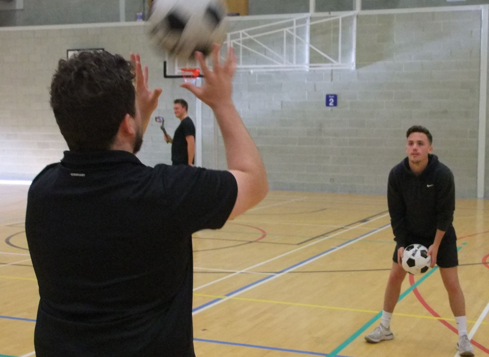 a student throwing a ball