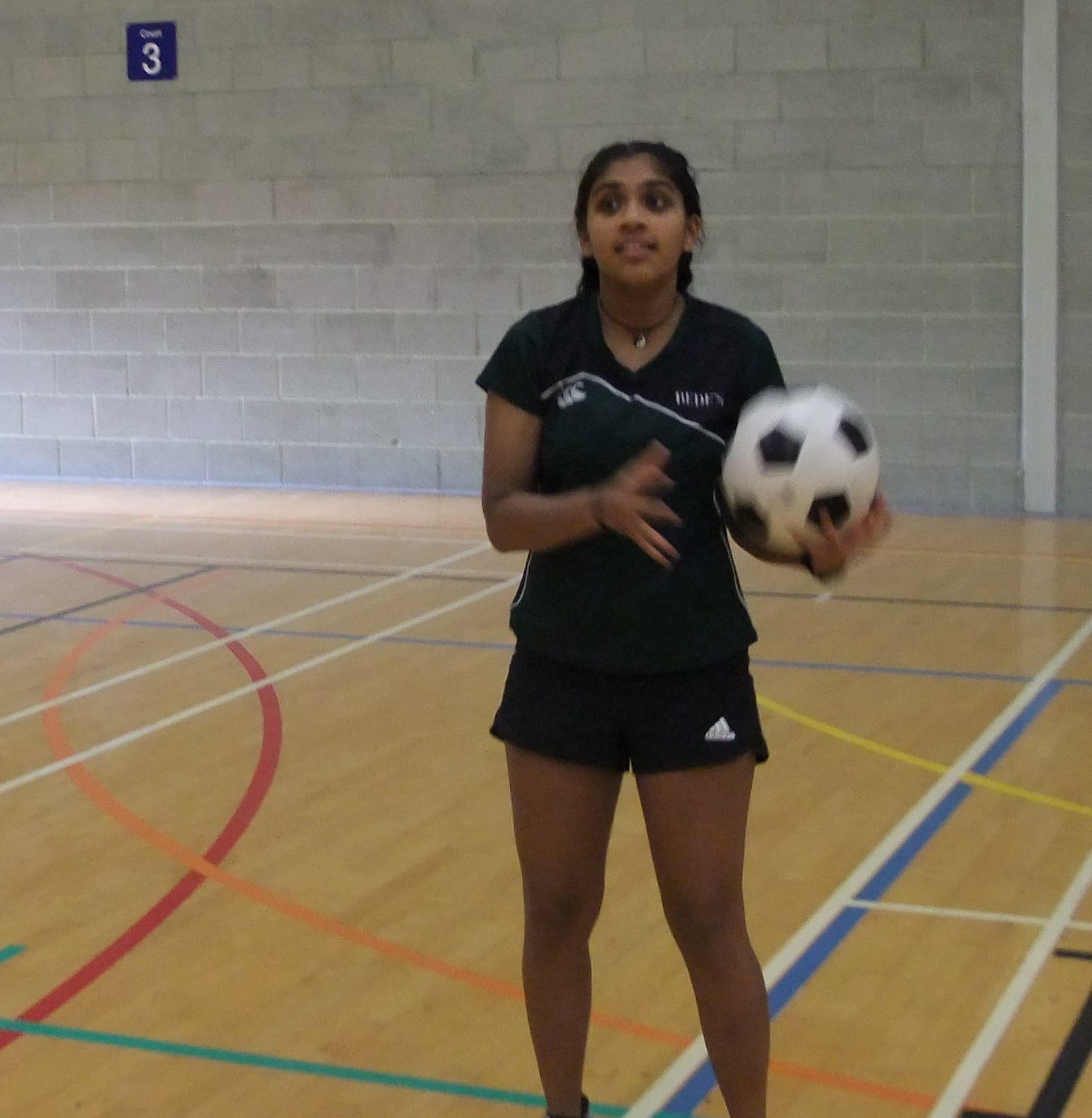 a female student holding a ball