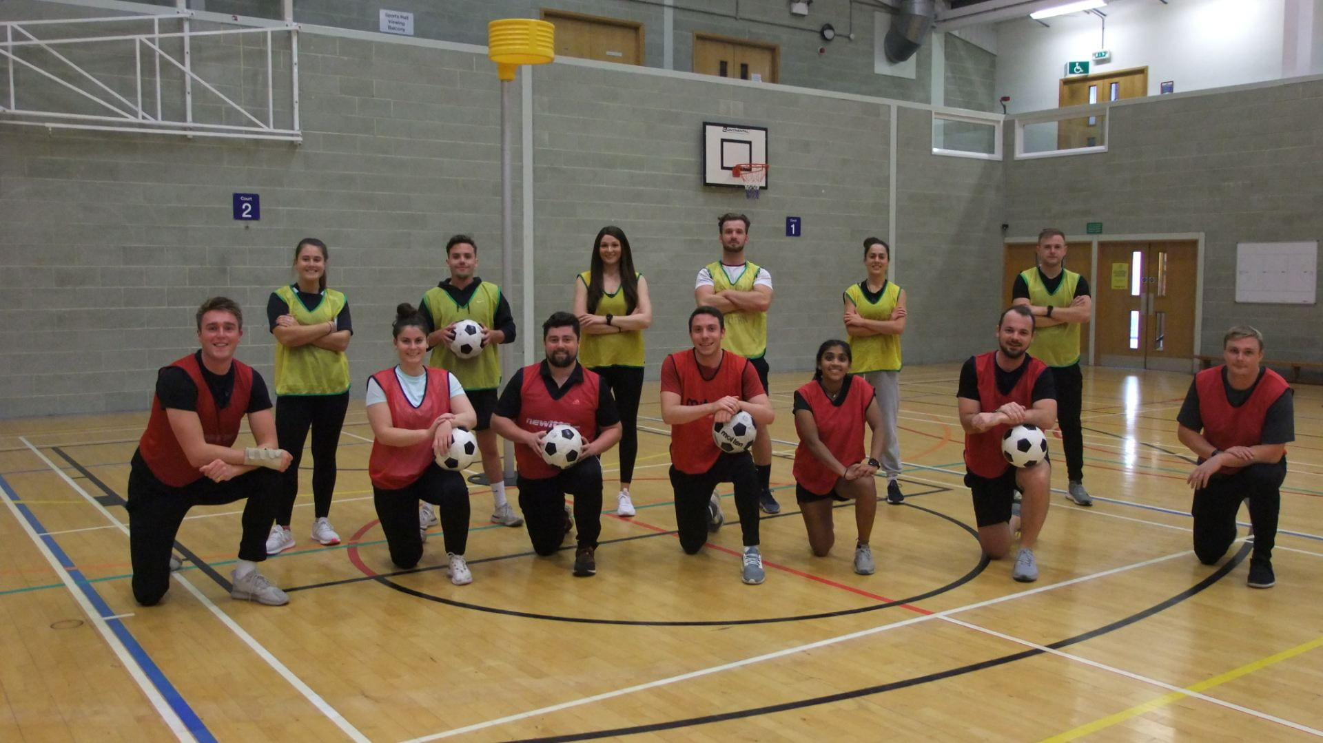 group photo of the students in the sports hall