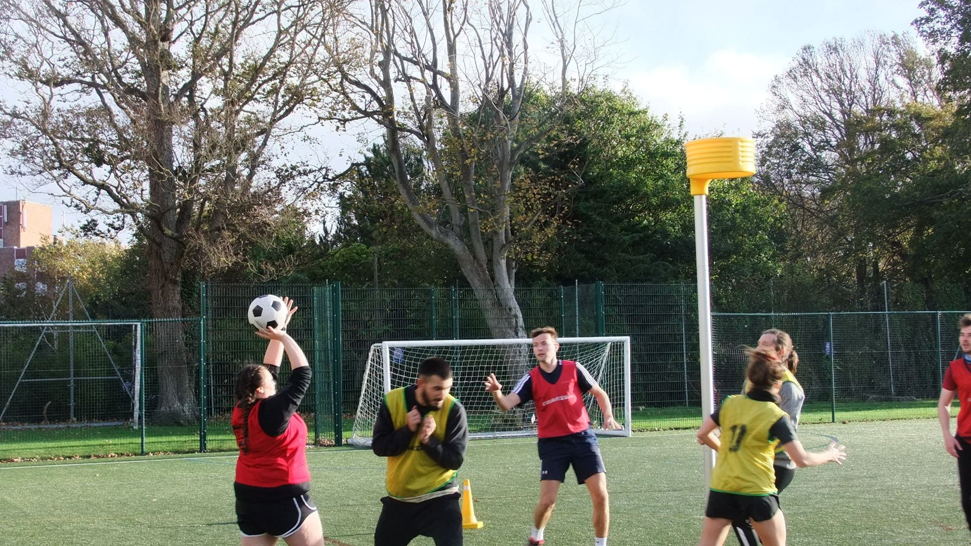 students playing on the outdoor pitch