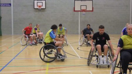 students playing wheelchair basketball in the gym