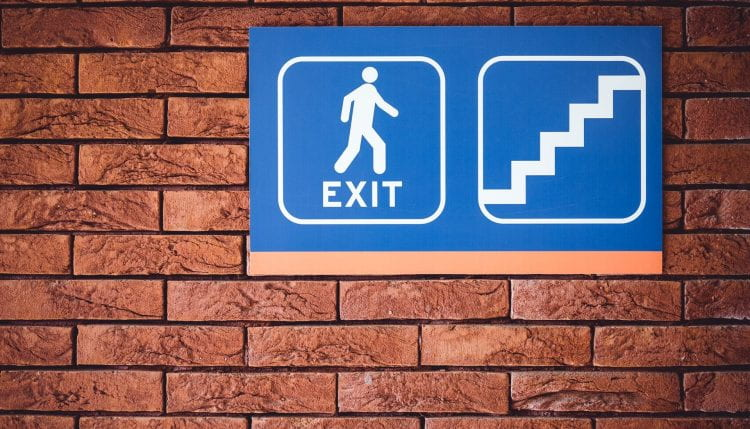 Building sign showing fire exit on stairs