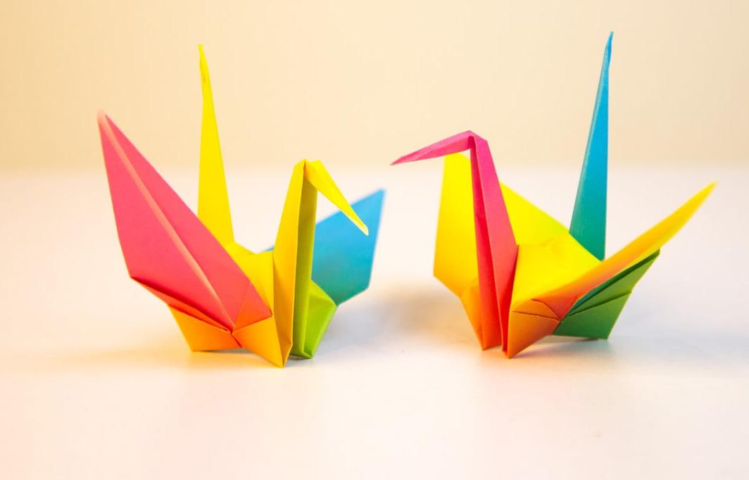 Two colourful origami cranes