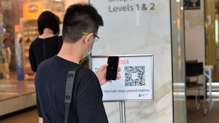 Student scanning QR code for track and trace