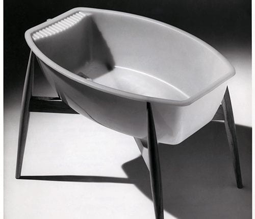 A black and white photographs showing an Ekco Gold Seal Superbath baby bath by Ekco Plastics Ltd. Designed by MO Rowlands MSIA. One of twenty products recognised in the COID 'Designs of the Year', 1958. Design Council Archive, University of Brighton Design Archives.