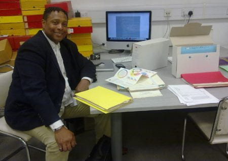 An image of Professor Ricardo Gomes IDSA on his research visit to the University of Brighton Design Archives in 2011.