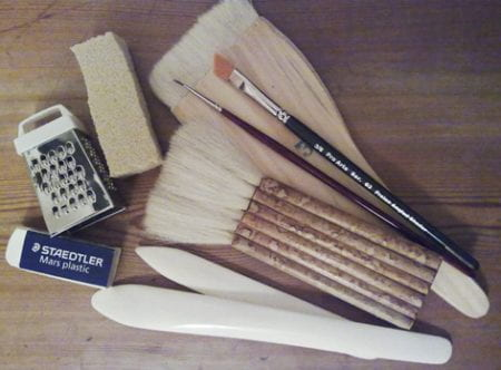 A colour image showing a selection of tools used in paper conservation. Taken by Sirpa Kutilainen of University of Brighton Design Archives.