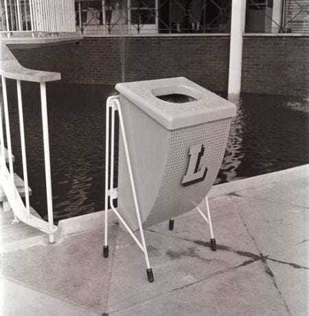 A black and white photographic print showing one of the outdoor litter bins at the Festival of Britain South Bank exhibition site. Designed by Jack Howe. From the Design Council Archive housed at the University of Brighton Design Archives.