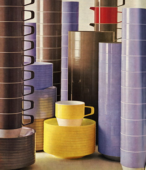 A colour image of colourful plastic cups and saucers piled up high