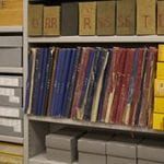 Archive books and boxes with coloured spines