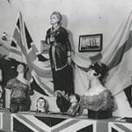 Royal ceramics memorabilia together with Union Flag display, black and white photograph