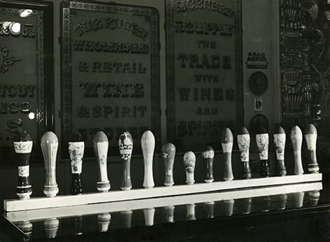 A black and white photograph showing beer-pump handles exhibited at the exhibition Black Eyes and Lemonade at the Whitechapel Art Gallery, 1951.